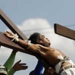 Penitent is nailed to a wooden cross during the re-enactment of the crucifixion of Jesus Christ on Good Friday.
