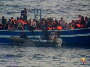 "A handout photo released by the Italian Navy on March 18, 2014 and taken on March 17, 2014 shows migrants standing on a boat during a rescue operation carried out by the Italian Navy near the Italian island of Lampedusa. The Italian navy said it had rescued nearly 600 Syrian, Palestinian and Eritrean migrants crossing the Mediterranean in two overcrowded boats, including 62 minors. The Italian frigate Grecale pulled 323 Syrians and Palestinians to safety late on Monday, after helping rescue another 273 migrants from Eritrea, who were taken aboard the gunboat Sfinge, the navy said in a statement. AFP PHOTO / ITALIAN NAVY - RESTRICTED TO EDITORIAL USE - MANDATORY CREDIT ""AFP PHOTO / ITALIAN NAVY "" - NO MARKETING NO ADVERTISING CAMPAIGNS - DISTRIBUTED AS A SERVICE TO CLIENTS"