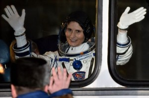 European Space Agency's Italian astronaut Samantha Cristoforetti waves from a bus after her space suit was tested at the Russian-leased Baikonur cosmodrome, prior to blasting off to the International Space Station (ISS) late on November 23, 2014. The international crew is scheduled to blast off to the ISS from Baikonur early on November 24. AFP PHOTO/KIRILL KUDRYAVTSEV