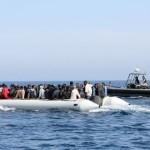 Libyan coast guards escort a boat carrying illegal migrants, who had hoped to set off to Europe with the help of people smugglers from the coastal town of Garabulli, towards the Libyan navy to the capital, Tripoli, prior to their arrest on June 6, 2015. Libya has a coastline of 1,770 kilometres (more than 1,000 miles). It is just 300 kilometres from the Italian island of Lampedusa, which many migrants fleeing poverty and conflict aim for as their gateway to Europe. AFP PHOTO / MAHMUD TURKIA