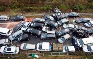 epa03008583 A general view of the aftermath of a car pile up that took place overnight on the A31 motorway between Heek and Gronau-Ochtrup in Germany, 19 November 2011. One woman and two men died in a 52-car pileup in foggy conditions late on 18 November on an expressway in northern Germany, authorities said. The accident left 35 people injured, including 14 in serious condition, a police spokeswoman in North Rhine-Westphalia state said. She described the wreckage-strewn roadway was a 'debris field.' Many of the injured were trapped in their cars and had to be freed by emergency workers, who rushed to the scene from a wide area. It was not immediately clear if the reduced visibility from fog was the cause of the accident, the spokeswoman said.  EPA/WILFRIED GERHARZ  EPA/ROLF VENNENBERND
