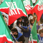 Militants hold Forza Italia's flag befor