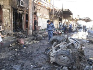 Iraqi security forces inspect the site of a bomb attack in Hilla, 100 km (60 miles) south of Baghdad, March 20, 2012. Car and roadside bombs exploded in cities and towns across Iraq on Tuesday, killing at least 29 people, police and hospital sources said, extending a spate of violence ahead of next week's Arab League summit in Baghdad.  REUTERS/Habib (IRAQ - Tags: CONFLICT POLITICS CIVIL UNREST)