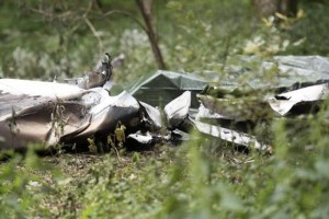 epa05425417 A general view shows debris from a burned Piper PA-32 which crashed on 14 July, in the woods at Predmeja village near Ajdovscina, some 50 kilometers west of Ljubljana, Slovenia, 15 July 2016. According to reports, all four people aboard the plane were killed in the crash, among the victims was Unister founder Thomas Wagner, according to media reports.  EPA/IGOR KUPLJENIK
